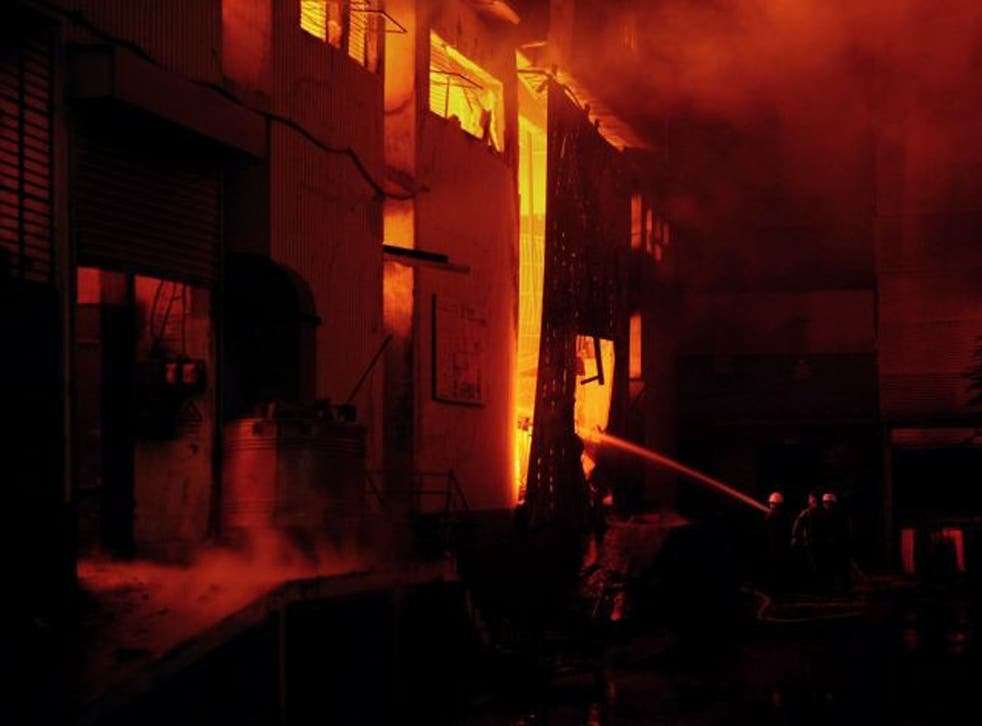 Firefighters battle the blaze at one of the factories in Karachi