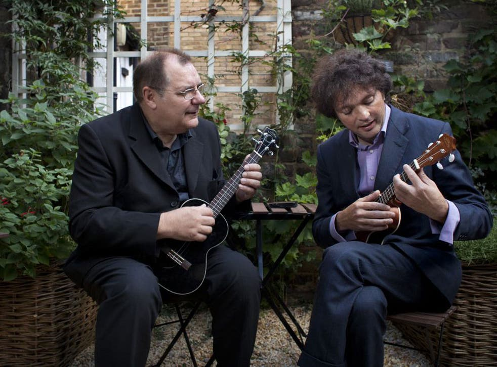 George Hinchliffe, left, gives Tom Hodgkinson a masterclass in the ukulele