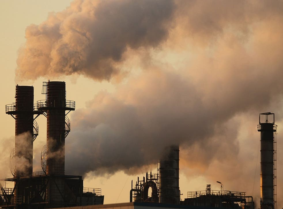 Fumes emit from factories of Keihin Industrial Area on December 1, 2009 in Kawasaki, Japan.