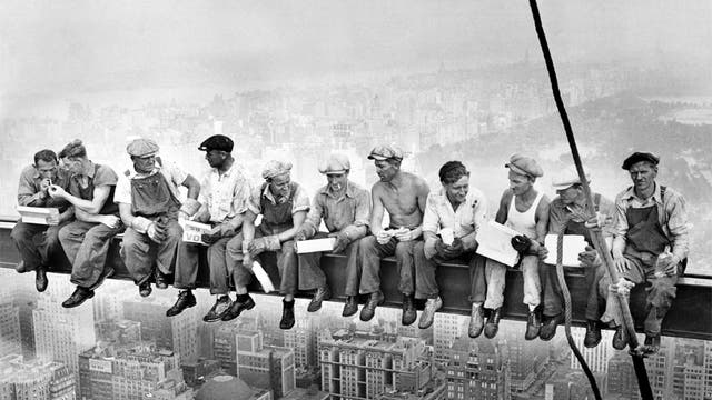 The 11 men sit eating lunch high above New York