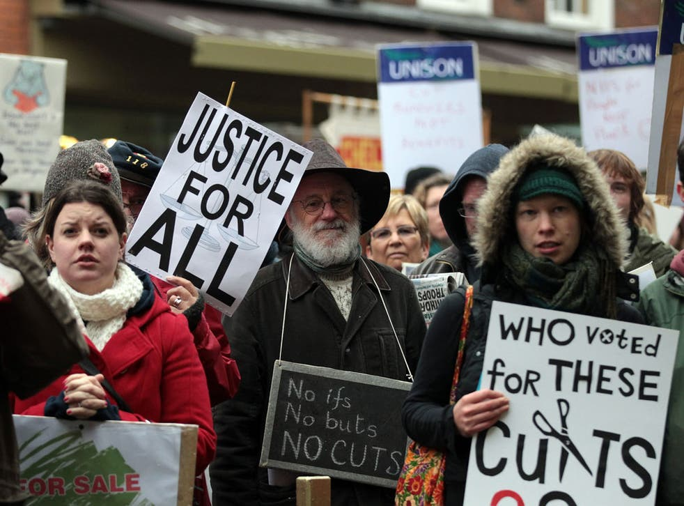 GLOUCESTER, ENGLAND - NOVEMBER 20: Protesters from the gather in front of the steps of the Shire Hall
