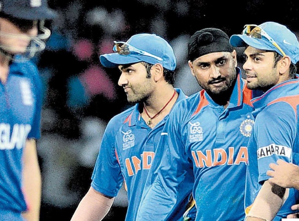 Harbhajan Singh is flanked by delighted team-mates after taking Tim Bresnan's wicket yesterday