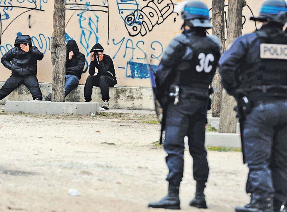 Police try to maintain order in the troubled and poverty-stricken suburbs of Marseille, the poorest city in France