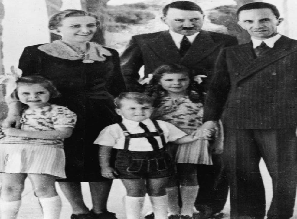 Genocidal German dictator and Nazi leader Adolf Hitler (1889 - 1945), centre, stands with Nazi Propaganda Minister Joseph Goebbels, his wife Magda and their three oldest children, left to right, Hilda, Helmut, and Helga
