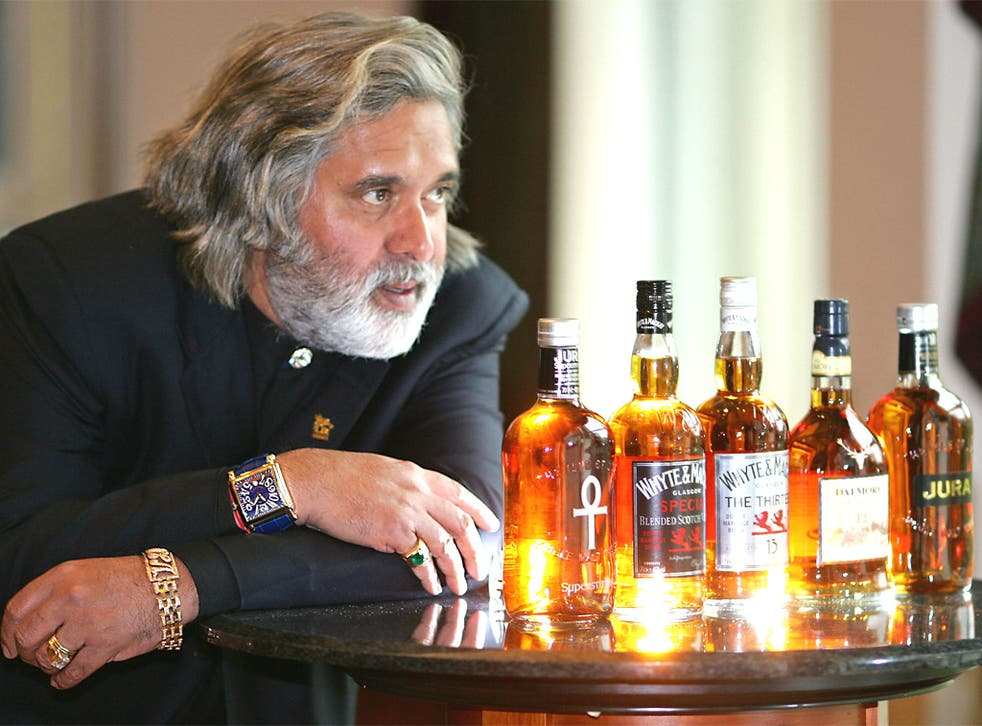 Vijay Mallya with some of his whisky brands