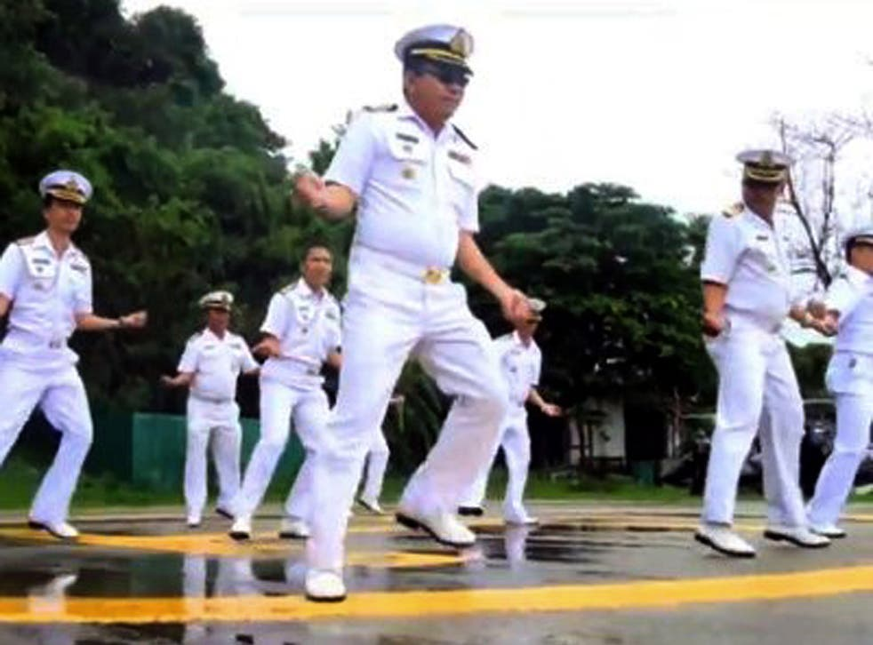 In this image made from an undated video released by Thai Royal Navy, Thai sailors perform the rodeo-style dance and other hip-shaking moves at their base on the popular tourist island of Phuket, southern Thailand.