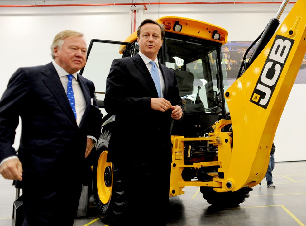 Sir Anthony Bamford, left, owner of JCB, invited David Cameron, right, to open the company's new factory in Sao Paulo, Brazil, last week