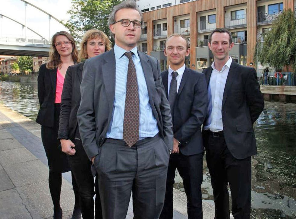Andreas Wesemann with members of staff – before the photoshoot was interrupted by hecklers