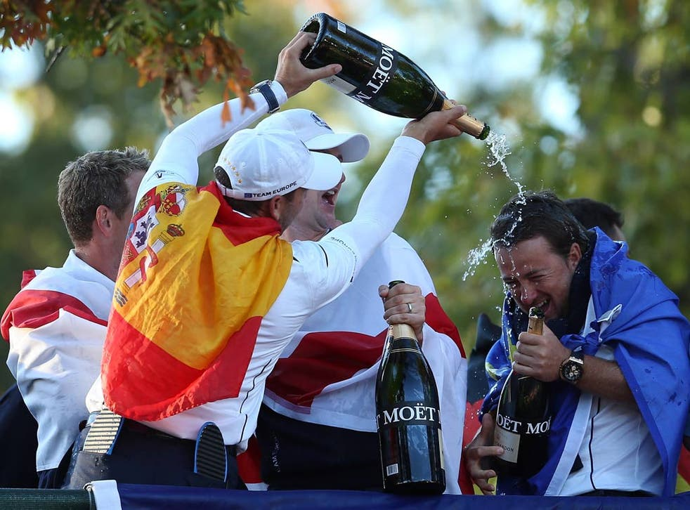 Sergio Garcia, Luke Donald, Nicolas Colsaerts and Graeme McDowell of Europe celebrate after helping their team defeat the United States