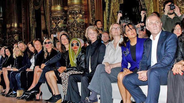 Front row of celebrities (from left): Nancy Shevell; Sir Paul McCartney; Kate Moss; Mario Testino; the rapper M.I.A; the actress Charlotte Ramplin; the actress Salma Hayek; François-Henri Pinault, the chief executive of luxury goods firm PPR