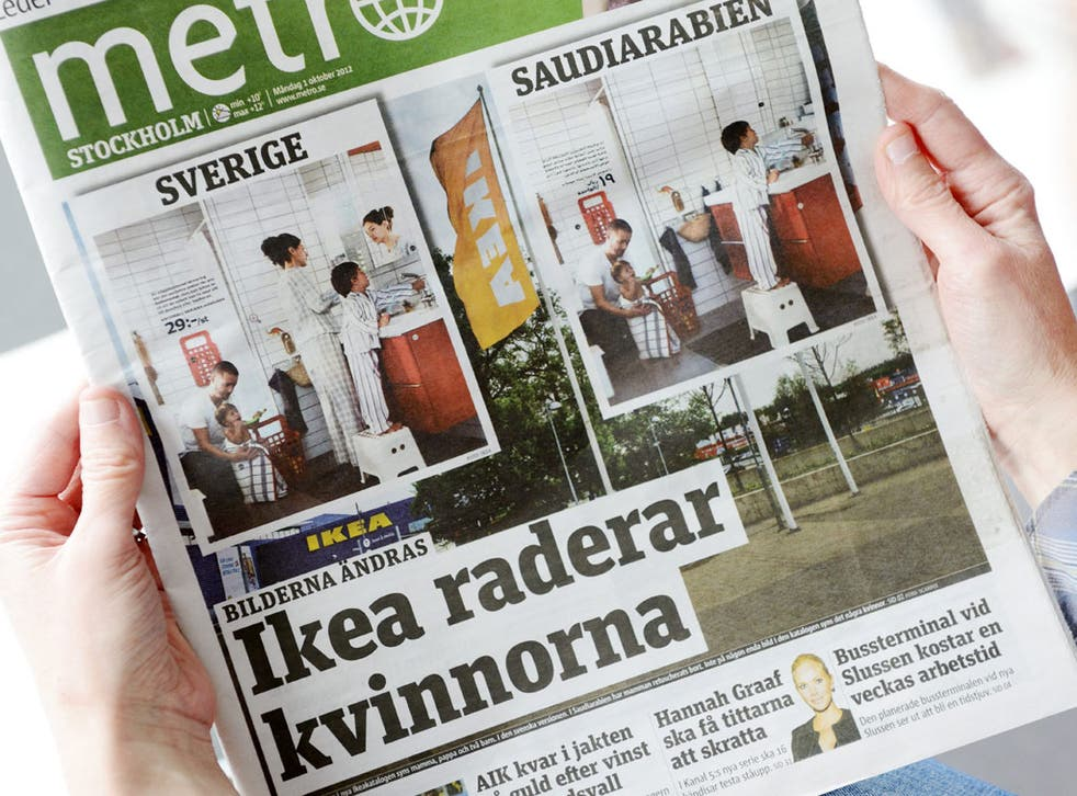 A person holds in Stockholm the October 1, 2012 issue of the free daily Metro newspaper, featuring two versions of the same photo from Swedish furniture giant Ikea's yearly catalogue