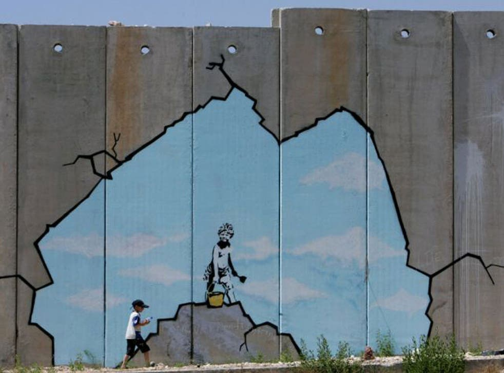 Epochal changes: barrier near Qalandiya checkpoint, on the West Bank