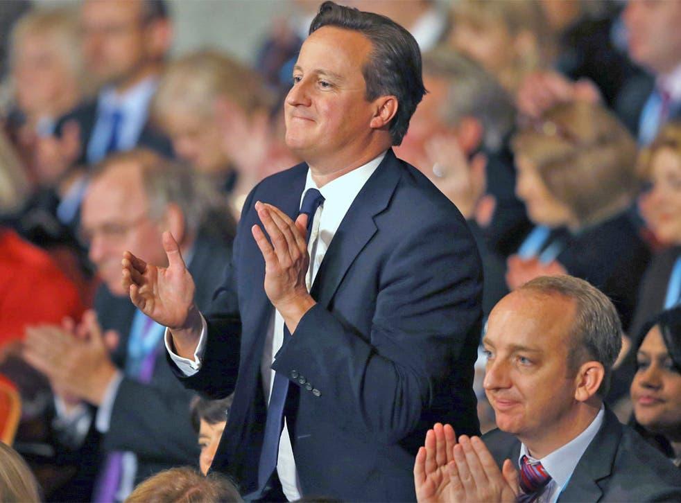 Prime Minister David Cameron applauds Boris Johnson's speech yesterday