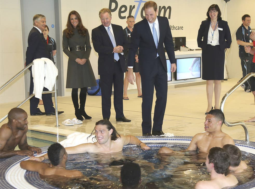 The Duke and Duchess of Cambridge greet England footballers as they soak in the hot-tub at St George's Park