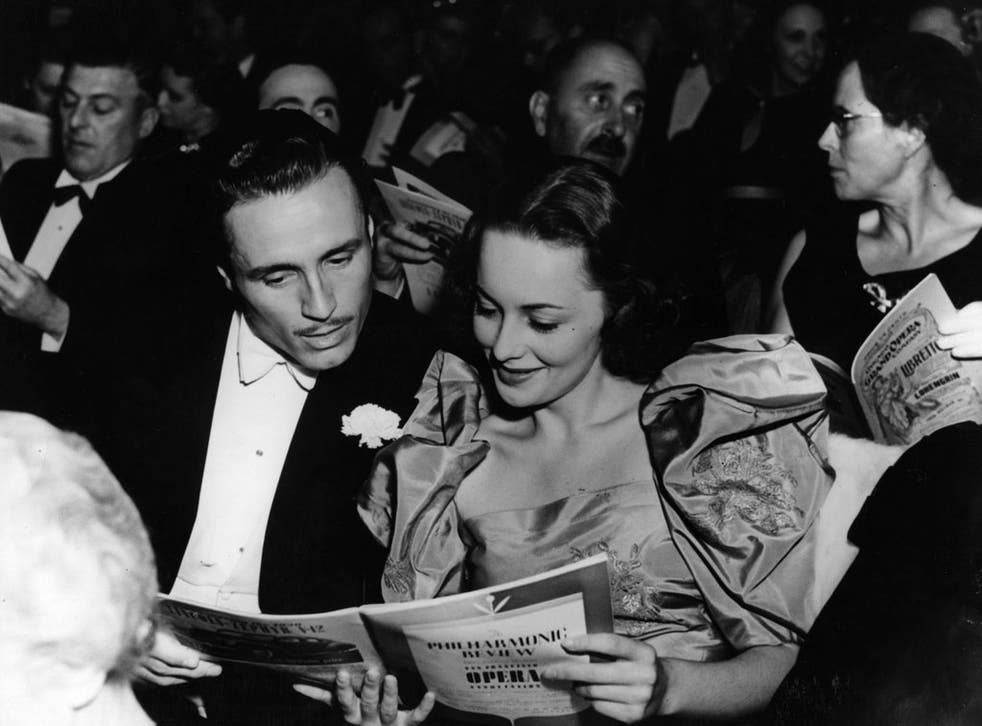 circa 1939: Hollywood screen star Olivia De Havilland at the opera with American actor Billy Bakewell
