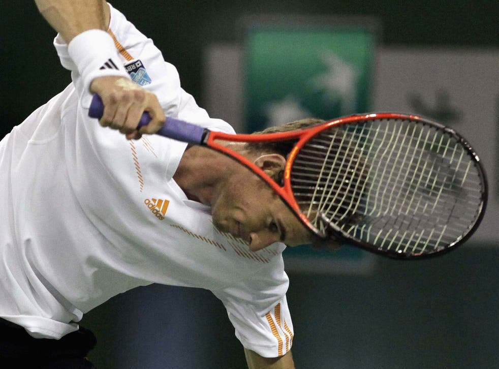 Andy Murray smashes his racket after his opponent broke back