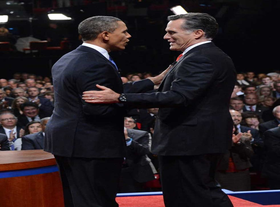 Can we...? We can! Barack Obama and Mitt Romney shake hands at the end of the presidential debate