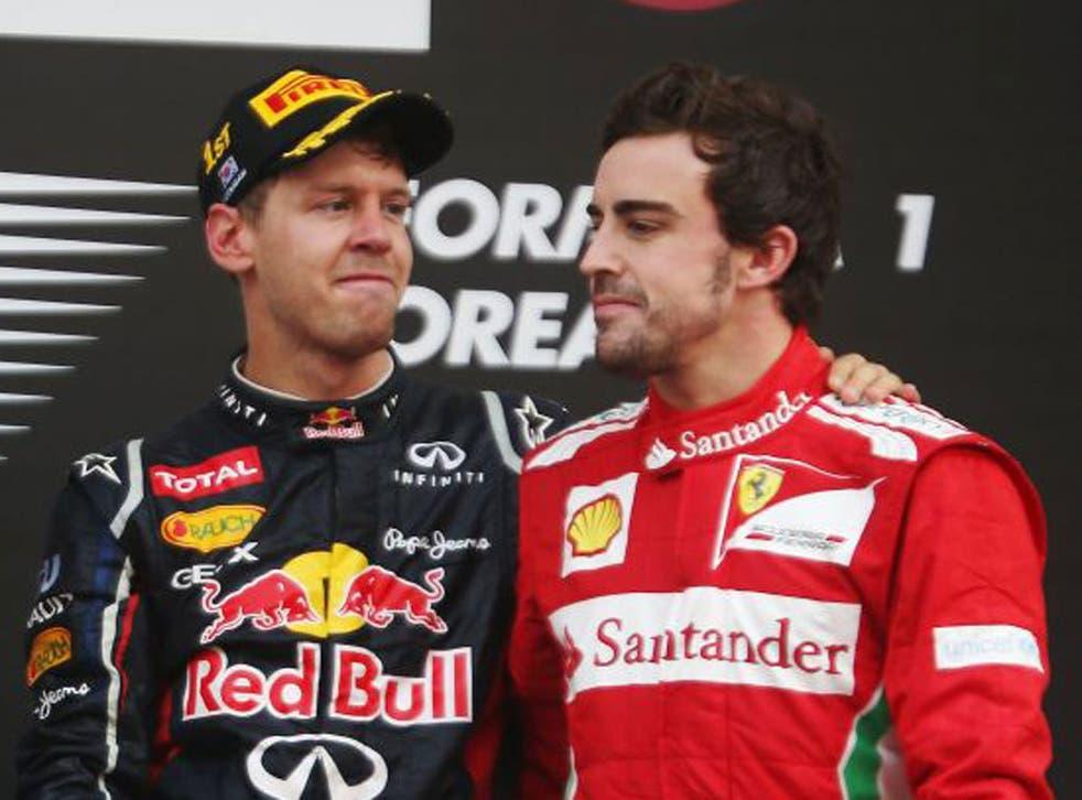Rivals Sebastian Vettel (left) and Fernando Alonso