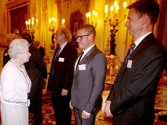 The Queen talks to TV chef Heston Blumenthal before hearing Jeremy Hunts badly-received joke