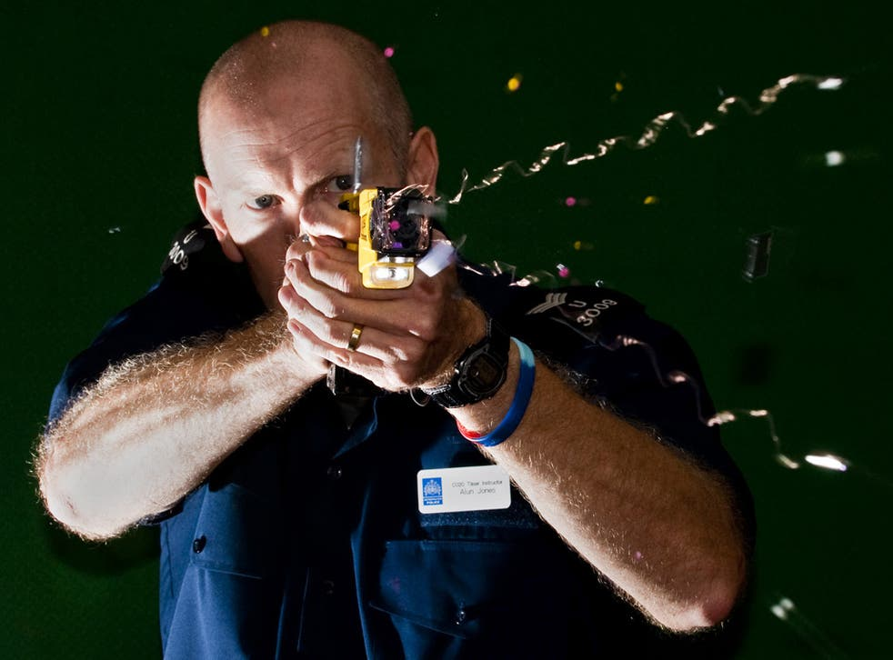 A police officer demonstrates the firing of a Taser
