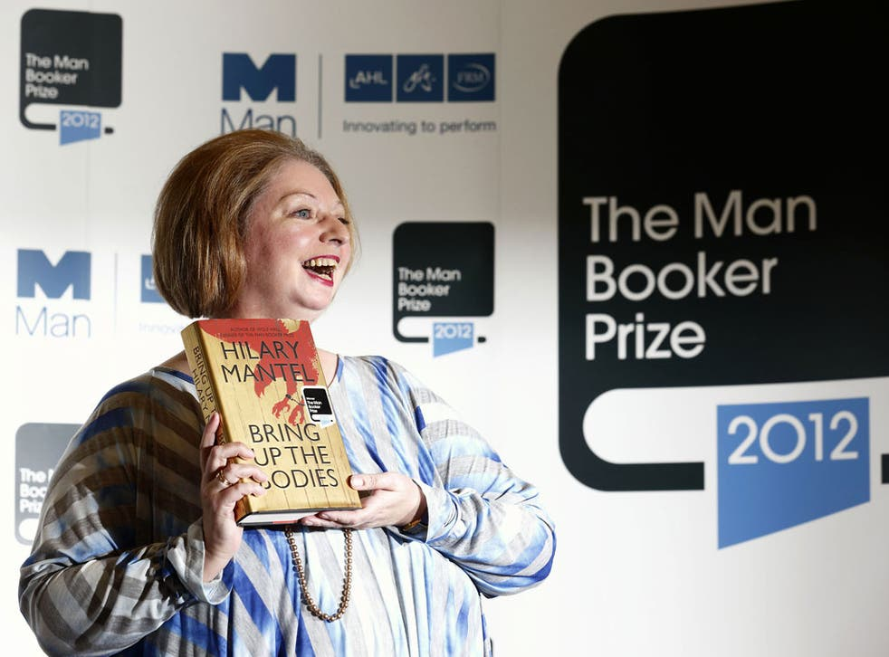 British author Hilary Mantel poses for pictures after winning the 2012 Man Booker literary prize for her novel 'Bring Up The Bodies' in London on October 16, 2012.