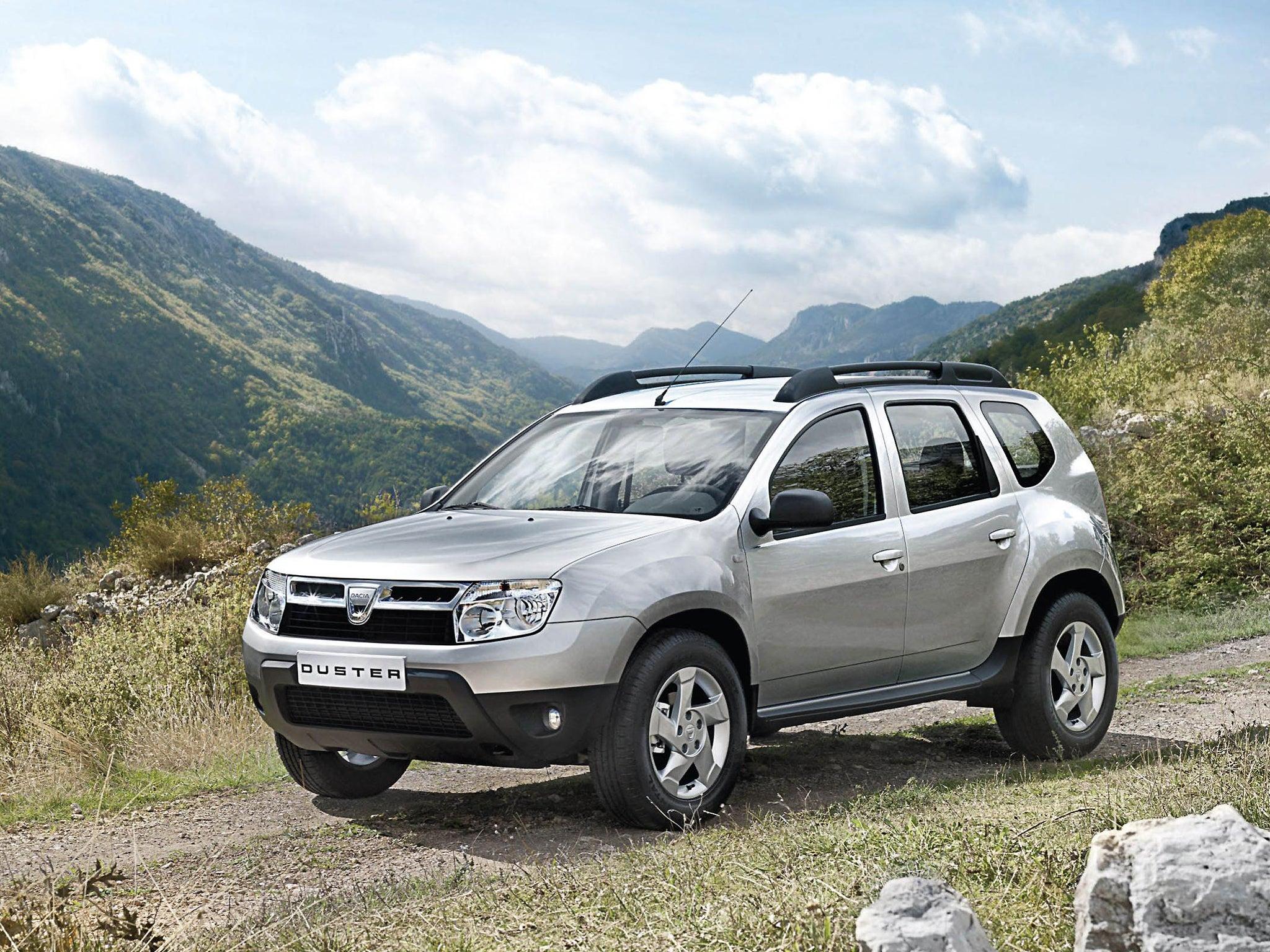 Dacia duster laureate dci 110 4x4 first drive the for Interni dacia duster laureate
