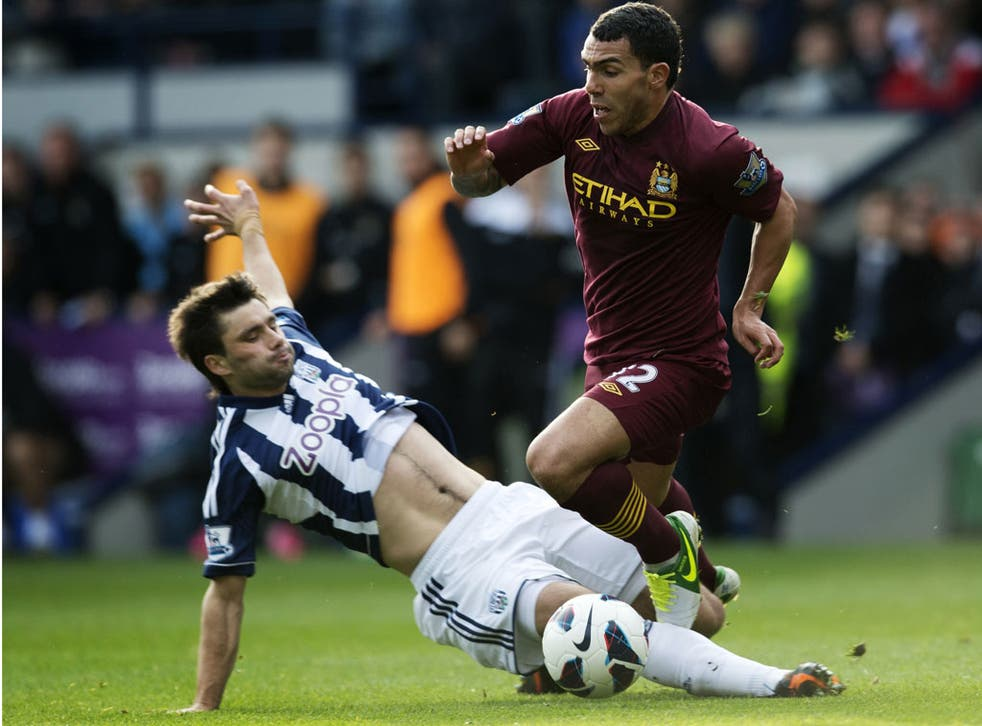 Carlos Tevez runs with the ball during Manchester City's game with West Brom