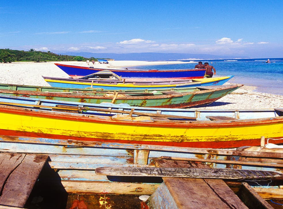 Catch of the day: Bright kayaks and fishing boats line the beach