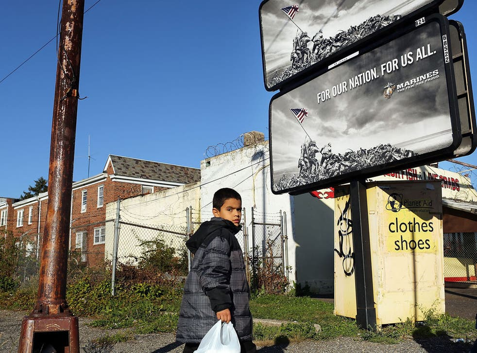 Poverty trap: A child in Camden, New Jersey, the most impoverished US city