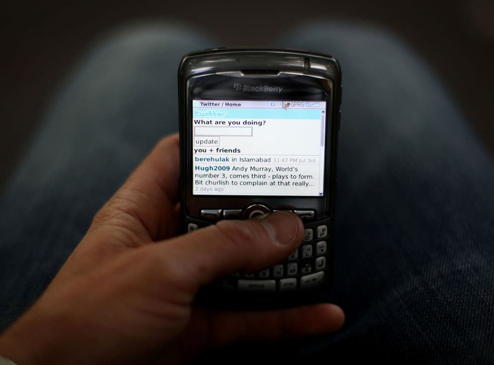 In this photo illustration the Twitter website is displayed on a mobile phone on July 6, 2009 in London.