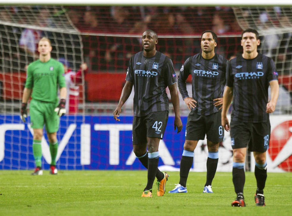 Dejected City players regroup on Wednesday night