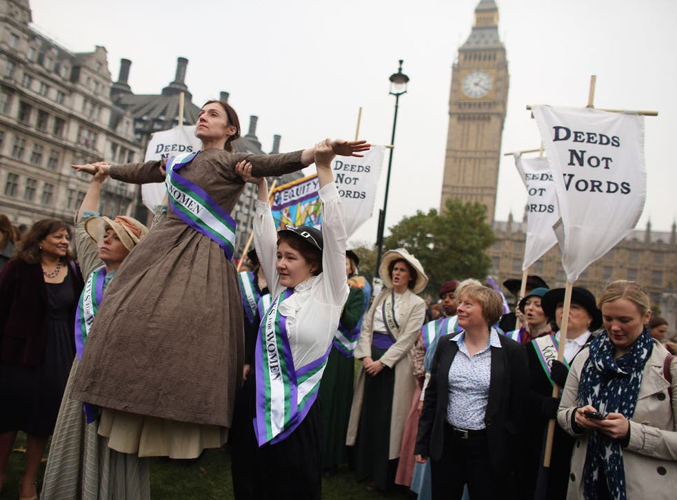 Campaigners dressed as suffragettes attend a rally organised by UK Feminista to call for equal rights for men and women on October 24, 2012 in London, England.