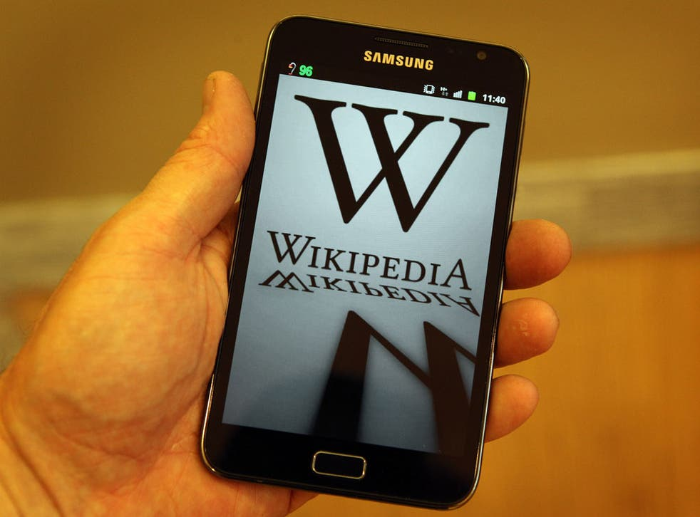 A mobile device shows Wikipedia's front page displaying a darkened logo on January 18, 2012 in London, England.