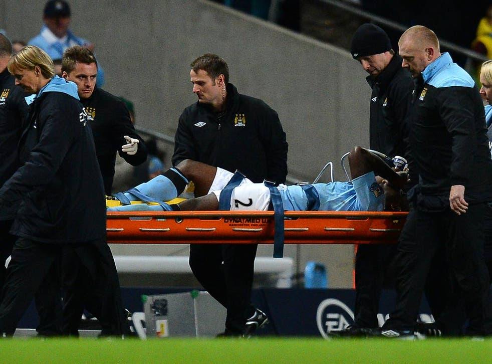 Micah Richards is taken off in the Premier League game against Swansea