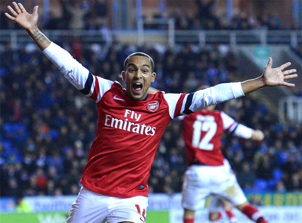 Arsenal's Theo Walcott celebrates scoring against Reading last night