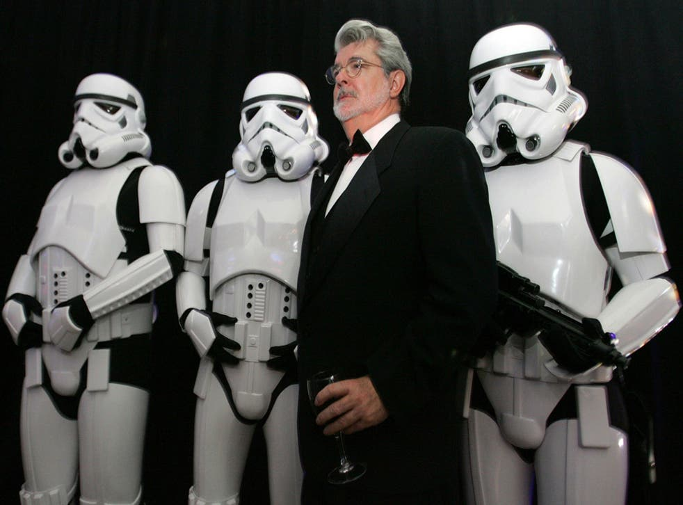 Three more episodes? Star Wars creator George Lucas poses with Storm Troopers in 2005. Disney is planning to make a further three Star Wars films if a buyout of Lucasfilm goes ahead