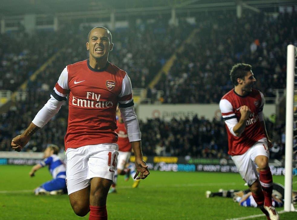 Theo Walcott celebrates the sixth goal for Arsenal