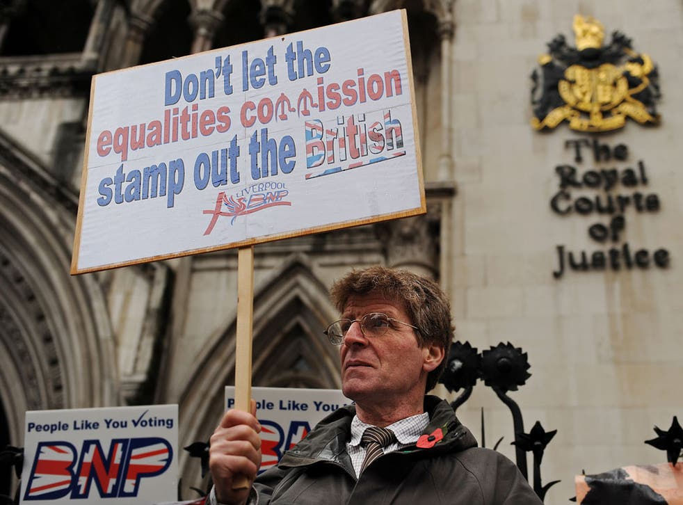 BNP supporters gather outside the High Court in central London on November 8, 2010 to protest against the Equality and Human Rights Commission.