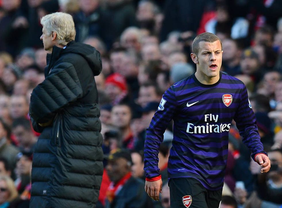 Jack Wilshere in action against Manchester United