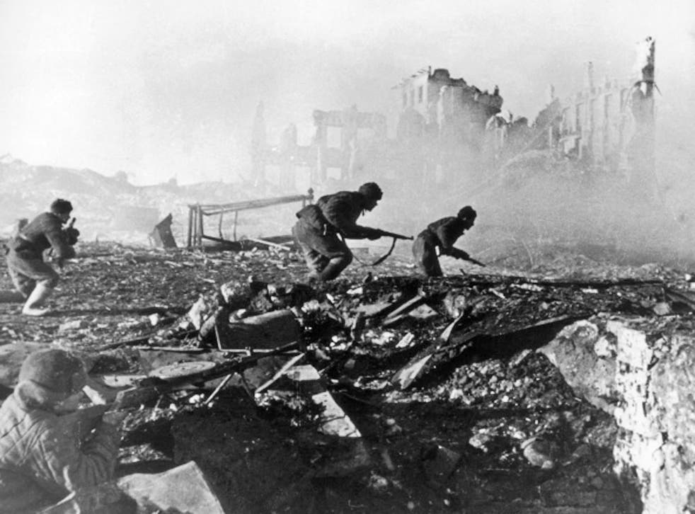 Red Army troops storm a building, and German prisoners, below, during the Battle of Stalingrad