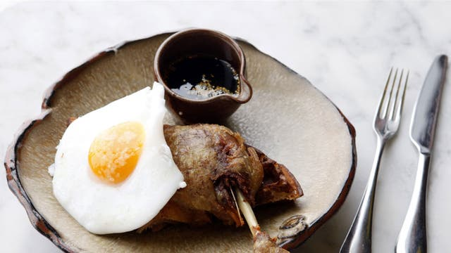 The dish making foodies go quackers: duck leg with waffles, egg and maple syrup, prepared by Tom Cenci