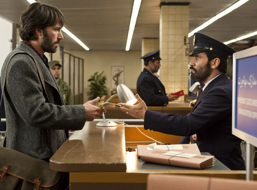 Ben Affleck, left, plays CIA agent Tony Mendez in 'Argo', which he also directed