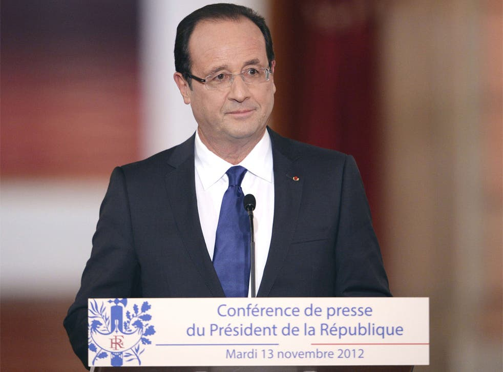 France's President, François Hollande, defends his first six months in office in the face of plunging national approval ratings