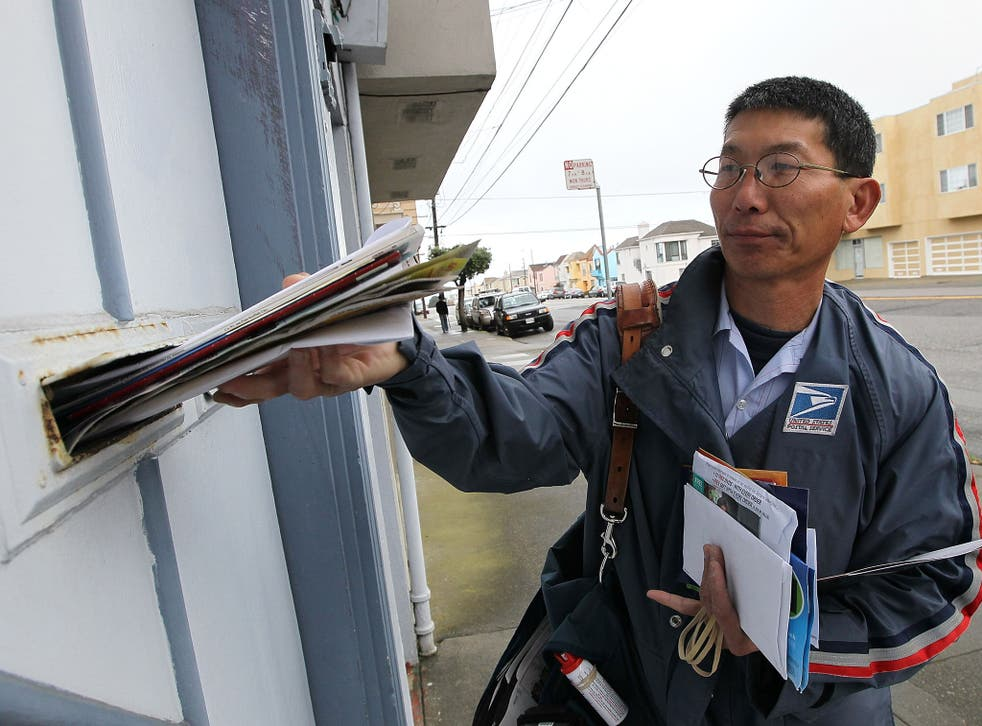 US Postal Service lettercarrier Raymond Hou delivers mail along his route