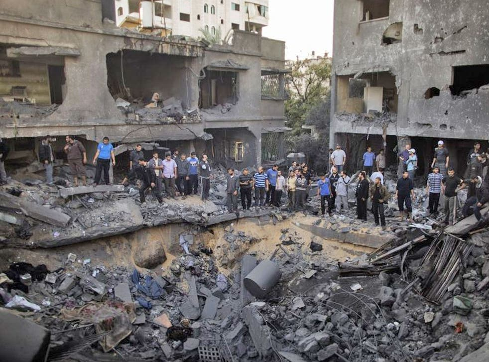 The aftermath of the Israeli air strike on the al-Dallu family home