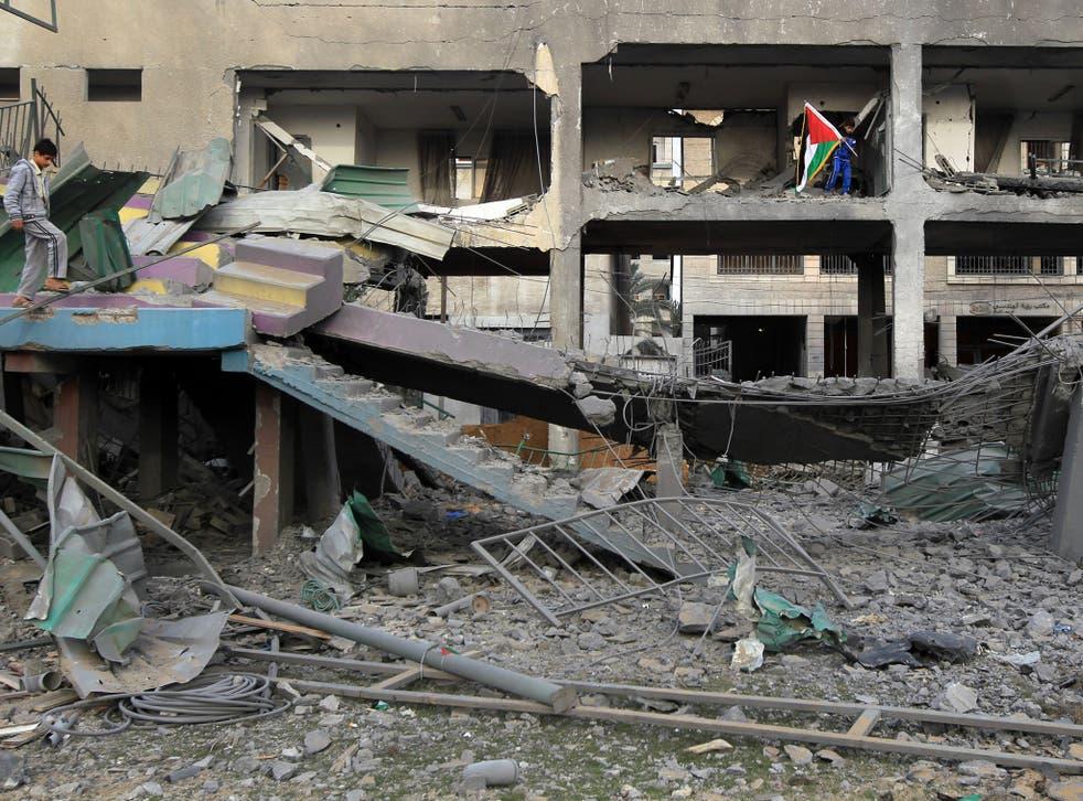 Boys inspect the rubble in Gaza City