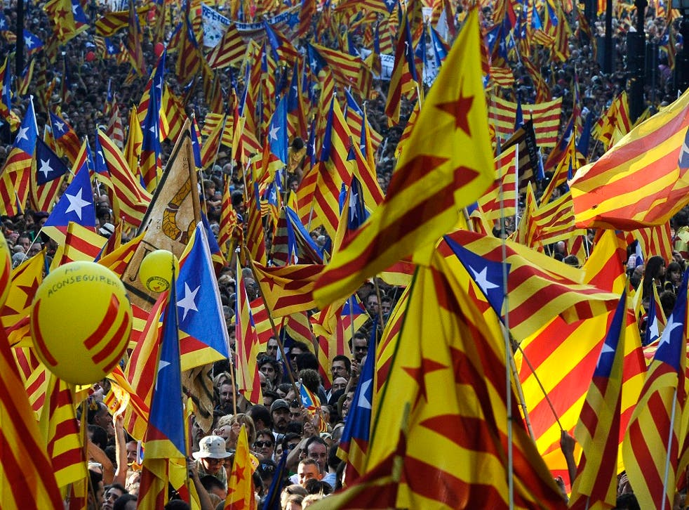 People hold Pro-independence Catalan flags in a demonstration calling for independence during the Catalonia's National Day on September 11, 2012