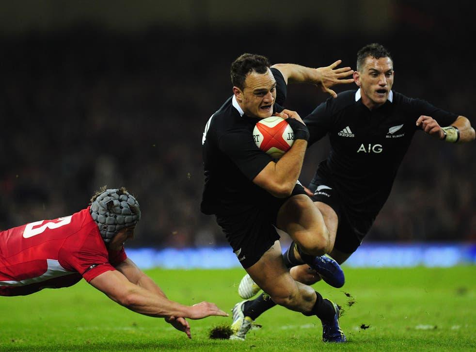 New Zealand All Blacks fullback Israel Dagg runs at the Wales defence