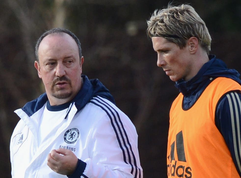 Helping hand: New manager Rafa Benitez gets straight down to work with Fernando Torres on the Chelsea training ground