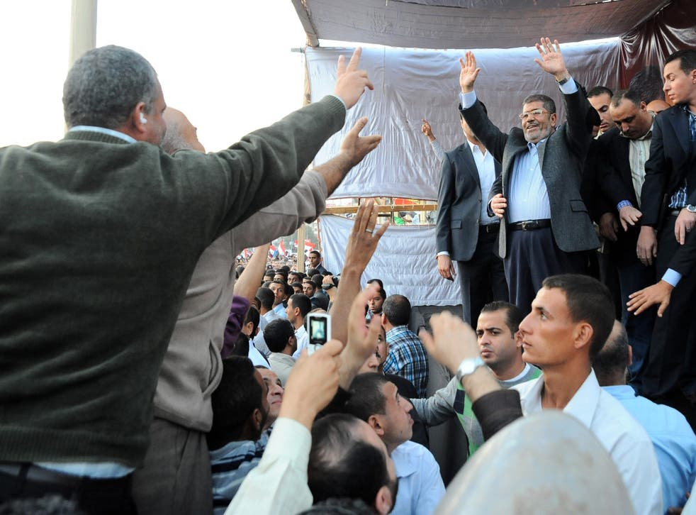 Mohamed Morsi addresses crowds in Cairo on Friday